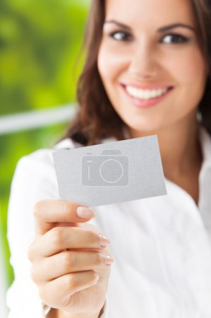Businesswoman showing blank business card