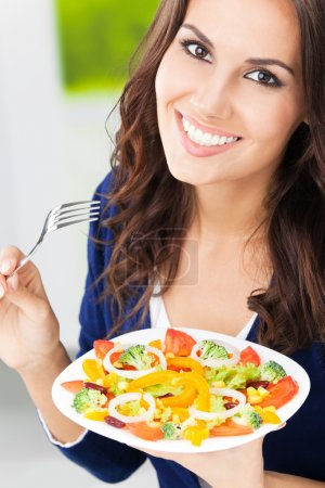 Young woman with salad, outdoors