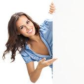 Beautiful young woman showing blank signboard