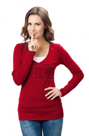 Woman keeping finger on her lips, isolated