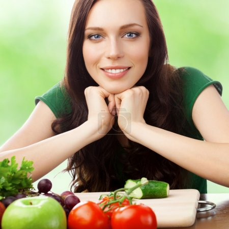 Photo for Portrait of happy smiling young woman with vegetarian food, outdoors - Royalty Free Image