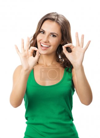Woman showing okay gesture, isolated
