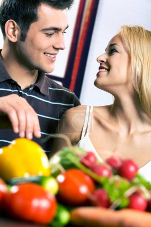 Photo for Young attractive happy smiling couple cooking at kitchen - Royalty Free Image