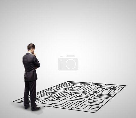 Photo for Pensive man in front of labyrinth - Royalty Free Image