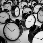 Many alarm clock on a gray background...