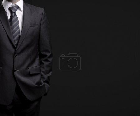 Photo for Man in suit on a black background - Royalty Free Image