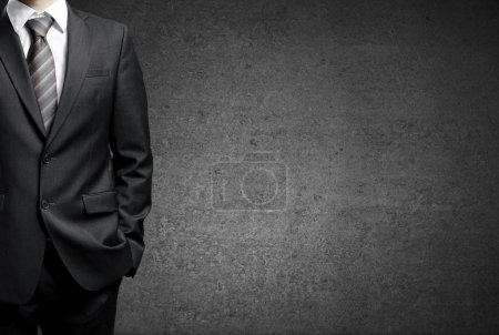 Photo for Man in suit on a concrete wall background - Royalty Free Image