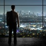 Businessman looks in night city...
