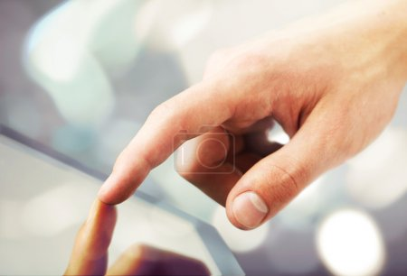 Photo for High resolution hand touching digital tablet - Royalty Free Image