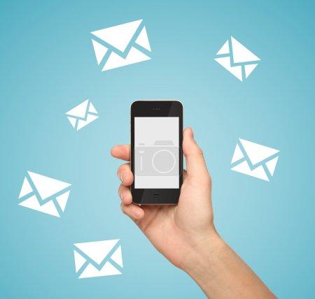 Photo pour Téléphone portable avec symbole e-mail - image libre de droit