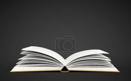 Photo pour Livre ouvert sur fond noir - image libre de droit
