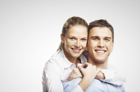 Photo for Smiling man and woman on white background - Royalty Free Image