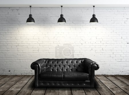 Photo for Leather sofa in brick room and three lamps - Royalty Free Image