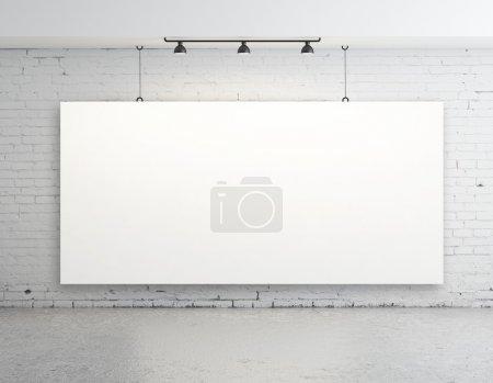 Photo pour Salle béton brique avec affiche sur le mur - image libre de droit
