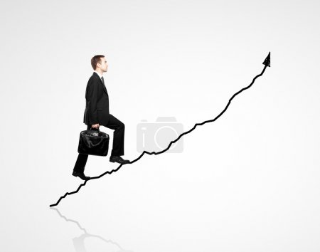 Photo for Man walking on chart on a white background - Royalty Free Image
