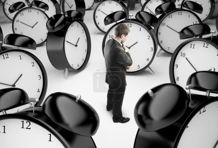 Photo for Thoughtful businessman and alarm clocks - Royalty Free Image