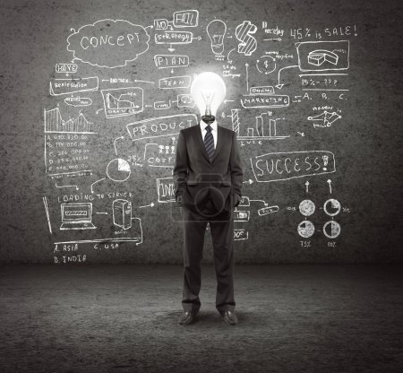 Photo for Bulb headed man and business plan concept on wall - Royalty Free Image