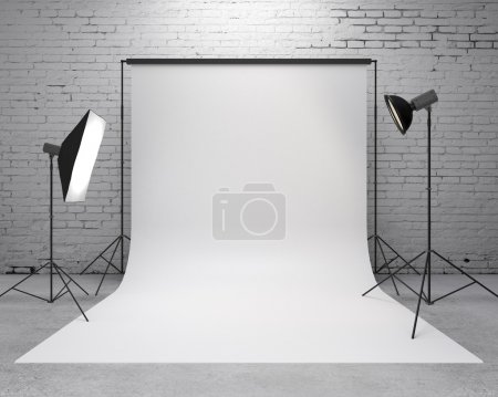 Photography studio with a light set-up and backdro...