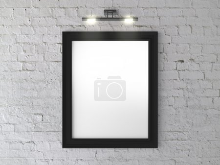 Photo for Black frame on wall with wall lamp - Royalty Free Image