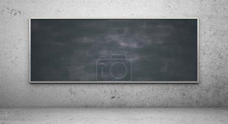 Photo pour Blackbord noir dans une pièce en béton - image libre de droit