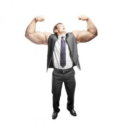 Photo pour Heureux homme d'affaires avec muscles main - image libre de droit