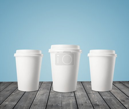 Photo for Three cup of coffee on wood table - Royalty Free Image