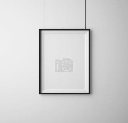 Photo pour Cadres noirs sur mur blanc - image libre de droit