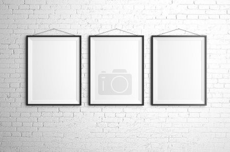 Photo for Three black frames on brick wall - Royalty Free Image