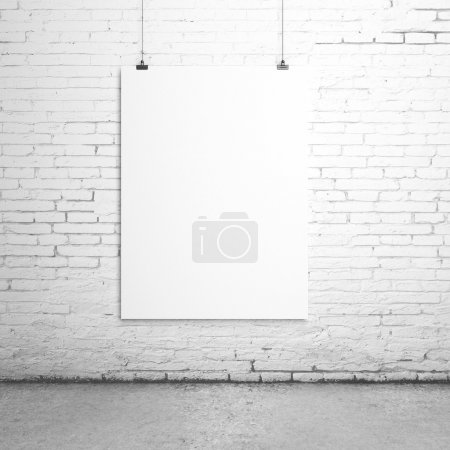 Photo for White blank paper clips on brick room - Royalty Free Image