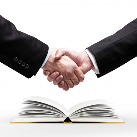 handshake and book