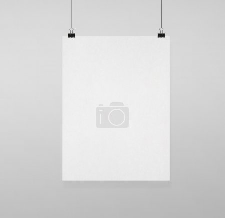 Photo for Blank poster clips on white wall - Royalty Free Image