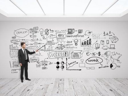 Photo for Businssman pointing at business concept on white wall - Royalty Free Image
