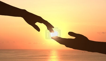 hands and sunset