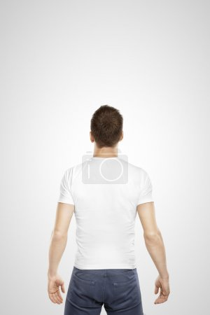 Photo for Young man standing back on a white background - Royalty Free Image