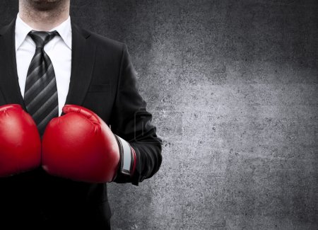 Photo for Businessman in boxing gloves on background - Royalty Free Image