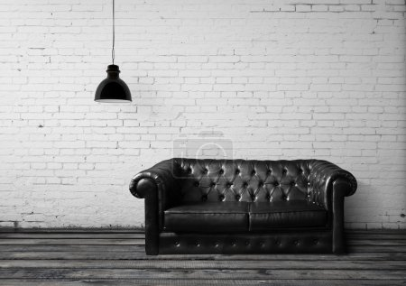 Photo for Brick room with leather sofa - Royalty Free Image