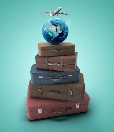Photo pour Sacs de voyage avec terre et avion - image libre de droit