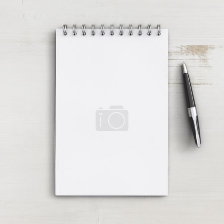 Photo for Blank notebook on a white wooden table - Royalty Free Image