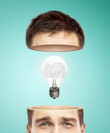 Photo for Half head and light bulb on a blue background - Royalty Free Image