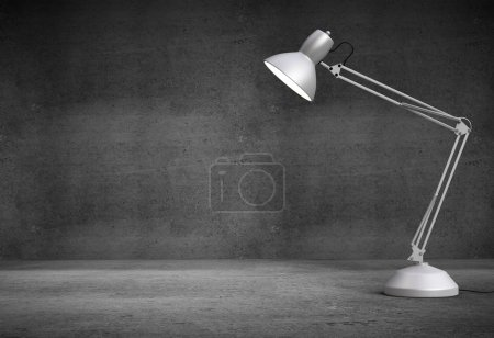 Photo for Vintage white desk lamp in concrete interior - Royalty Free Image