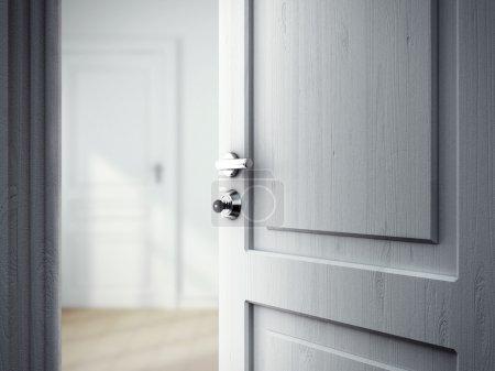 Photo pour Porte ouverte dans la chambre grise - image libre de droit