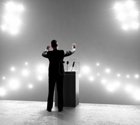 Photo for Businessman standing on podium and closes on outbreaks - Royalty Free Image