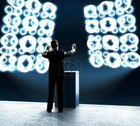 businessman standing on rostrum