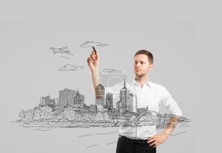 Photo pour Homme dessinant la ville abstraite du futur - image libre de droit