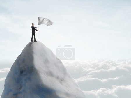 Photo for Young businessman standing on top of mountain with flag - Royalty Free Image