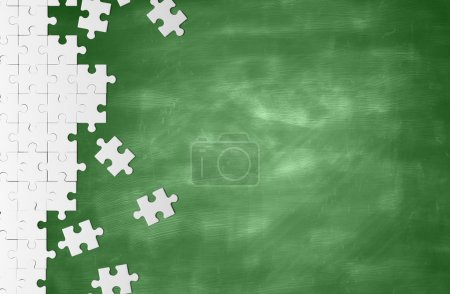 Photo for White puzzle on a green blackboard - Royalty Free Image