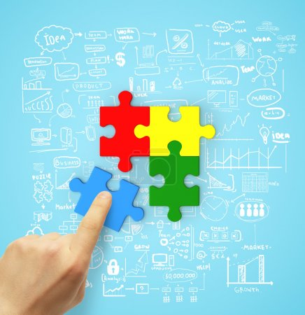 Photo for Hand holding color puzzle, business concept - Royalty Free Image