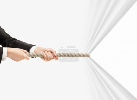 Photo for Hand pulling rope on a white background - Royalty Free Image