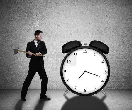 businessman breaks clock