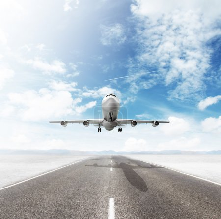 Photo for Airplane on runway and looking at airplane in blue sky - Royalty Free Image